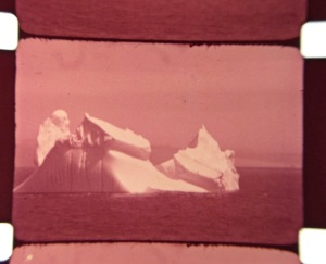 Faded to magenta image of an iceberg, 1934.